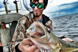 Logan with a big walleye on a Sportsman's Lodge Charter on Lake of the Woods.